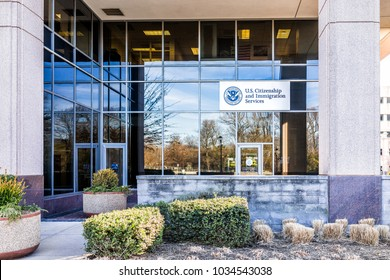 Fairfax, USA - January 26, 2018: USCIS US United States Citizenship and Immigration Services field main office entrance in Virginia with sign