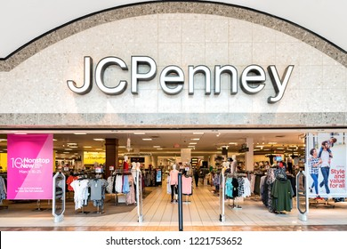 Fairfax, USA - March 13, 2018: Entranace to JCPenney department outlet, store, shop in Fair Oaks shopping mall in Northern Virginia with retail displays, hangers and people walking