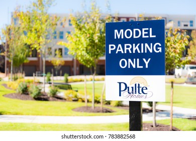 Fairfax, USA - October 1, 2017: Pulte Model Home Parking street sign with background of townhouses at mount vineyard in downtown city in Virginia
