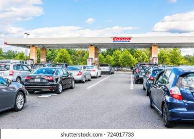 Fairfax, USA - September 8, 2017: People in cars waiting in long lines   to fill up vehicles with gas  at Costco store in Virginia