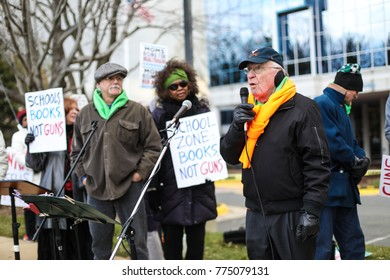 Fairfax, VA - December 14, 2017: Speeches are held outside of the National Rifle Association headquarters near Washington, DC on the fifth anniversary of the Sandy Hook Elementary School massacre.