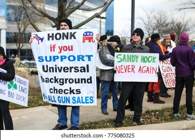 Fairfax, VA - December 14, 2017: Protesters gather outside of the National Rifle Association headquarters for a vigil in remembrance of the 2012 Sandy Hook Elementary School massacre in Newtown.