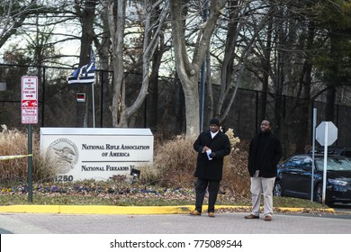 Fairfax, VA - December 14, 2017: Federal police and National Rifle Association officials stand at the entrance of the NRA headquarters on the anniversary of the Sandy Hook school shooting in Newtown.