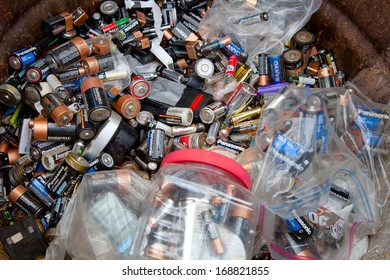 FAIRFAX, VA - DECEMBER 5: A load of used batteries lying in a recycling facility on December 5, 2013 in Fairfax, VA. The acid will be neutralized and polymers will be separated from the lead.