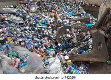 FAIRFAX, VA - JULY 24: Aluminum cans lying in a heap at an undisclosed recycling facility on July 24, 2013 in Fairfax, VA. The cans will be sent to an aluminum foundry.