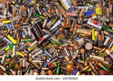 FAIRFAX, VA - NOVEMBER 21: Different types of used batteries lying in a heap at a recycling center on November 21, 2013 in Fairfax, VA. Types are AAA, AA, 9-volt and super heavy duty.