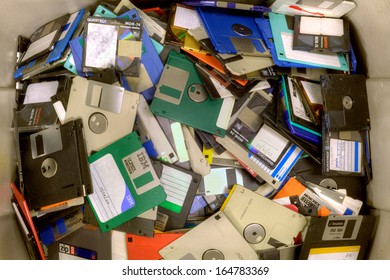 FAIRFAX, VA - NOVEMBER 21: Different types of obsolete floppy disks and diskettes lying in a heap at a recycling facility on November 21, 2013 in Fairfax, VA. Metal and plastic will be separated.