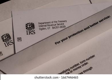 Fairfax, VA / USA - 02-20-20: IRS Penalty Notice letterhead and return envelope.