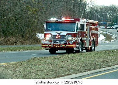 Fairfax, Virginia - January 22, 2019: A Fairfax County fire engine rushes to an emergency on a cold, winter afternoon near the intersection of Route 123 and Braddock Road by George Mason University.