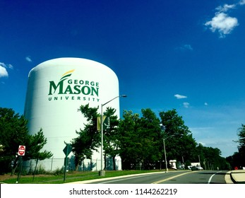 Fairfax, Virginia, USA - July 28, 2018: A large water tower with the George Mason University logo stands out against a blue sky on a sunny afternoon on the University's Fairfax campus.