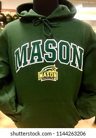 Fairfax, Virginia, USA - July 28, 2018: Close-up image of a sweatshirt for sale with the George Mason University logo emblazoned on its front.