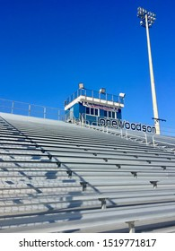 Fairfax, Virginia / USA - September 29, 2019: View looking up the bleachers toward the Lew Oppenheim Press Box at Pat Cunning Stadium at W.T. Woodson High School against a deep blue, clear sky.
