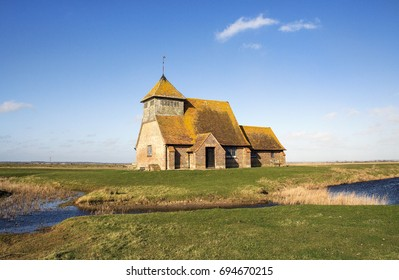 Fairfield, Kent: March 2016:  The 12th century Church of Thomas A Becket a former Archbishop of Canterbury. Rural church in Fairfield on Romney Marsh.