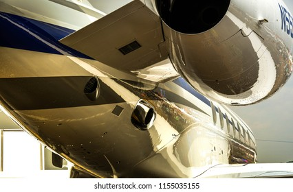 FAIRFORD, ENGLAND -JULY 2018:  Close up view of the fuselage and engine of a Gulfstream G550 executive jet on public display.