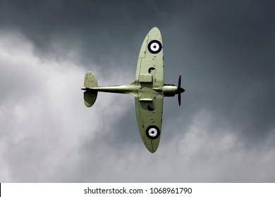 Fairford, Gloucestershire, UK - July 10, 2016: A Supermarine Spitfire Mk.IIa, P7350, flies in a stormy grey sky at the 2016 Royal International Air Tattoo at RAF Fairford, England