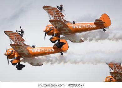 Fairford, Gloucestershire, UK - July 10th, 2016: AeroSuperBatics Breitling Stearman Wing Walking Formation Display Team perform at Royal International Air Tattoo