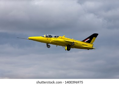 Fairford, Gloucestershire / UK - July 13 2014: The Heritage Aircraft Trust's Folland Gnat T. 1 XR992/XS102/G-MOUR pictured taking off at the 2014 Royal International Air Tattoo at RAF Fairford