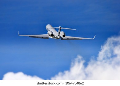Fairford, Gloucestershire, UK - July 14, 2007: A General Dynamics Gulfstream Aerospace G550 takes off into a deep blue sky