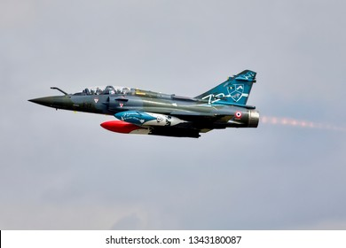 Fairford, Gloucestershire, UK - July 16 2018: A French Air Force Dassault Mirage 2000D Serial No. 624/3-IT takes off on full reheat