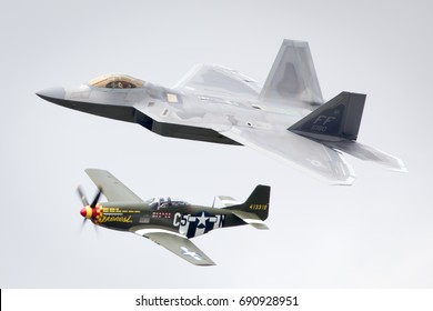 Fairford, Gloucestershire, UK - July 16th, 2017: Lockheed Martin F-22 Raptor and P-51 Mustang Heritage Flight performing at Fairford International Air Tattoo 2017, Sunday 16th July 2017