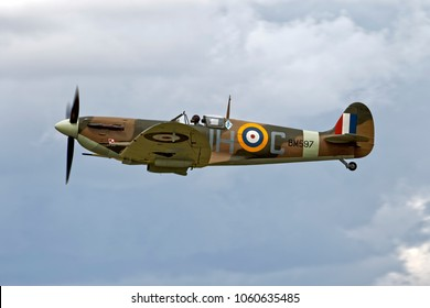Fairford, Gloucestershire, UK - July 17, 2010: A Supermarine Spitfire Mk.Vb flying in a cloudy sky