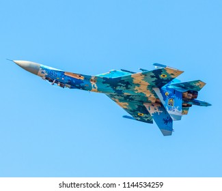 FAIRFORD, GLOUCESTERSHIRE/UK – JULY 15 2018: A Ukrainian Air Force Sukhoi Su-27 Flanker rolls inverted over RAF Fairford at RIAT 2018
