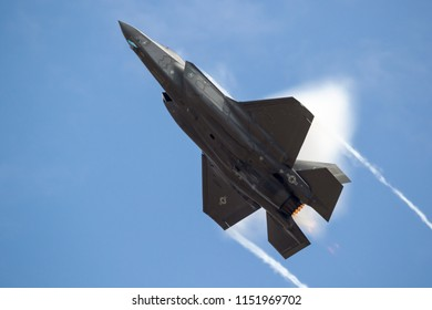 FAIRFORD, UK - JUL 13, 2018: US Air Force F-35 fighter jet full afterburner take off from RAF Fairford airbase.