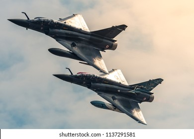 FAIRFORD, UK, JULY 13 2018: A photograph documenting the French Armee De L'air display team's Dassault Mirage 2000Ds fighter aircraft displaying at RAF Fairford f the Royal International Air Tattoo