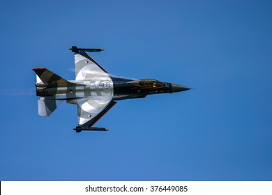 FAIRFORD, UK - JULY 16, 2006: General Dynamics F 16 Fighting Falcon aircraft performs at the Royal international air tattoo in Fairford, Gloucestershire, England.