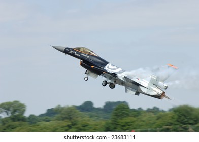 FAIRFORD, UK - JULY 16: Dutch F-16 in a special paint scheme takes off during an air demonstration at the Royal International Air Tattoo on July 16, 2005 in Fairford, UK.
