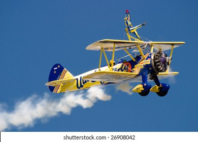 FAIRFORD, UNITED KINGDOM - JULY 15: The Utterly Butterly wing walking team performs at the Royal International Air Tattoo July 15 and 16, 2006 in Fairford.