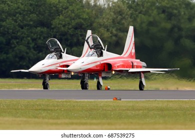 FAIRFORD, UNITED KINGDOM - JULY 16, 2017: Northrop F-5 of Patrouille Suisse aerobatics team performing demonstration flight at Royal International Air Tattoo show at Fairford AFB