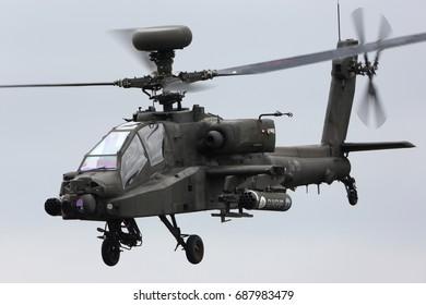 FAIRFORD, UNITED KINGDOM - JULY 16, 2017: AgustaWestland WAH-64D Apache AH1 ZJ203 of Army Air Corps performing demonstration flight at Royal International Air Tattoo show at Fairford AFB