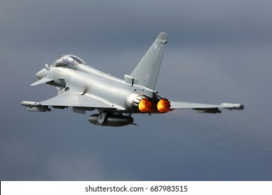 FAIRFORD, UNITED KINGDOM - JULY 16, 2017: Eurofighter Typhoon FGR4 ZK352 of Royal air force performing demonstration flight at Royal International Air Tattoo show at Fairford AFB