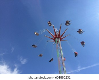 Fairground ride - merry-go-round - from below with blue sky background