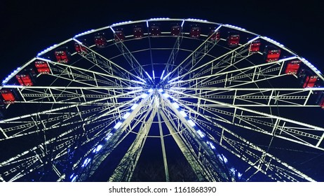 A fairground ride at night