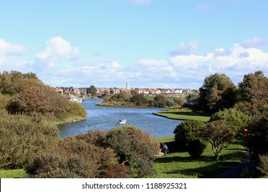 Fairhaven boating Lake at Lytham St Anne's, Lancashire with views across to the landmark tower of the White Church in the distance.