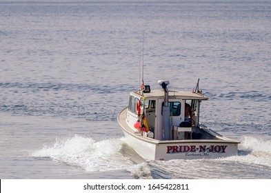 Fairhaven, Massachusetts, USA - August 4, 2019: Lobster boat Pride-N-Joy outbound from New Bedford on summer morning