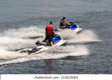 Fairhaven, Massachusetts, USA - June 30, 2018: Police riding personal watercraft crossing Acushnet River toward Fairhaven waterfront