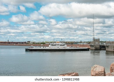 Fairhaven, Massachusetts, USA - May 15, 2019: Vehicle ferry Governor transiting New Bedford hurricane protection barrier