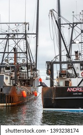 Fairhaven, Massachusetts, USA - May 2, 2019: Crewman throwing line to fisherman on adjacent boat as Andrea A., haling port Cape May, New Jersey, docks in Fairhaven