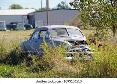 FAIRLAND, OKLAHOMA USA- OCTOBER 09: Car in Rural Vacant Lot 2013