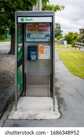 Fairlie, Mackenzie, New Zealand - 17 December 2019: SPARK Phone Booth with a public pay phone, operated with credit cards