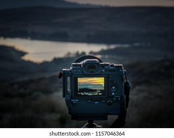 Fairlie, Scotland, UK - February 24, 2018: Rear view of Fuji XT-2 and attached Fuji Battery grip secured on unsceen trypod mount with mirrorless cameras like these increasing in popularity due to ligh