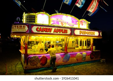 FAIRMONT, MN, USA - A colorful traveling carnival food vender stand offers customers candy apples and popcorn at the Martin County Fair. 8-2015