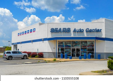 Fairview Heights, IL—June 1, 2018; car parked outside sears auto center location.  Sears is an American department store brand that offers vehicle maintenance services.
