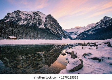 Fairview Mountain reflection in Lake Louise at Sunset in Winter - Banff National Park, Alberta, Canada