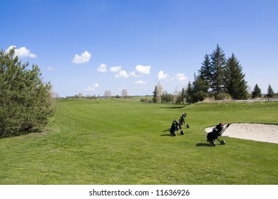 Fairway of golf course with sand traps and trolleys
