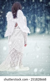 Fairy angel in snowfall / This image was created with costum white balance, filters, vignette and glow effects, and added some film noise