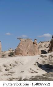 Fairy chimney balanced rock formations near Devrent, Cappadocia, Turkey